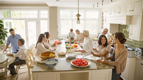 family in kitchen all in the family multigenerational living makes a