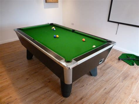 two local pool table re cover s and a new set of cushions