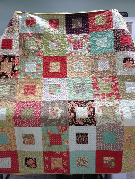 a quilt i made with a charm pack and a layer cake