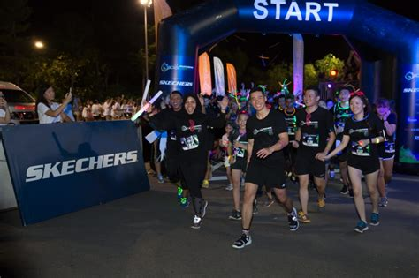 black light run 2017 participants lit up the sky at the skechers