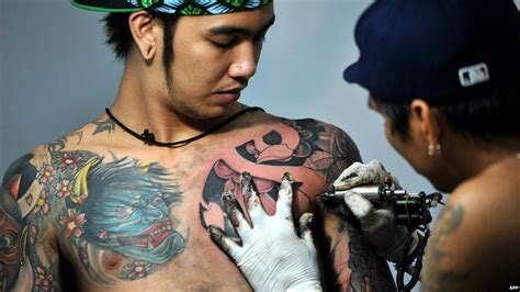 tattoo artist manila bbc news day in pictures 24 september