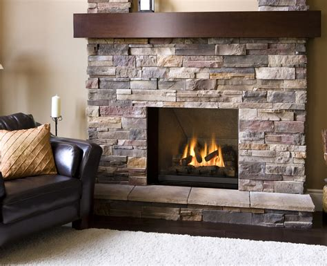 natural stone veneer firepalce with dark wood mantel