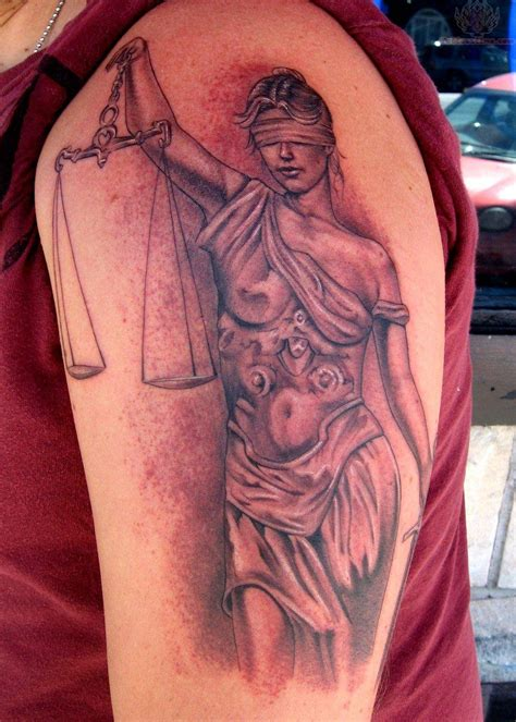 justice tattoo on sleeve