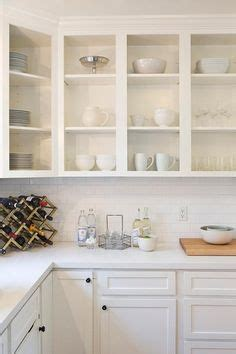 kitchen wall cabinets without doors raise your kitchen cabinets and add shelving underneath