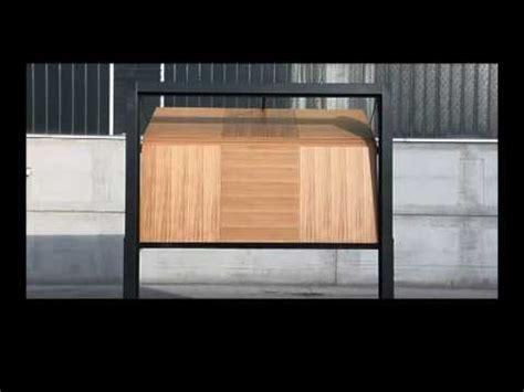 Domina Overlap Trackless Sectional Garage Door Youtube Trackless Garage Door