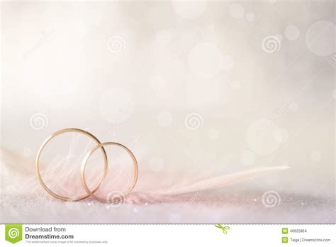 Wedding Rings No Background by Two Golden Wedding Rings And Feather Light Soft