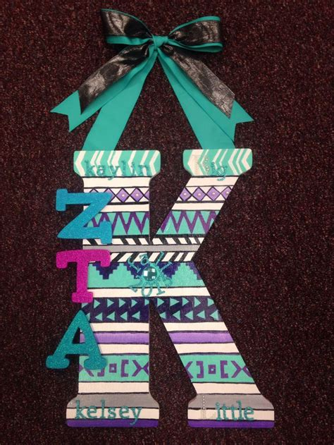 tribal pattern paddles inital with letters on it for the door alpha phi