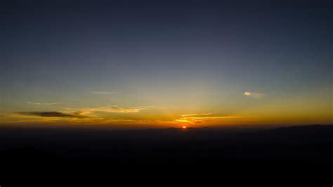 wallpaper  dawn horizon mountains sun