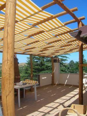 pali per gazebo in legno pergolato in castagno con teli 1 ispirazioni
