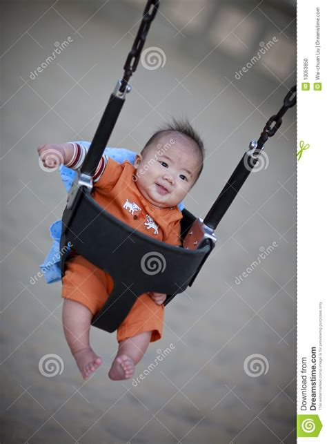 baby on a swing cute baby on a playground swing stock photo image 10053850