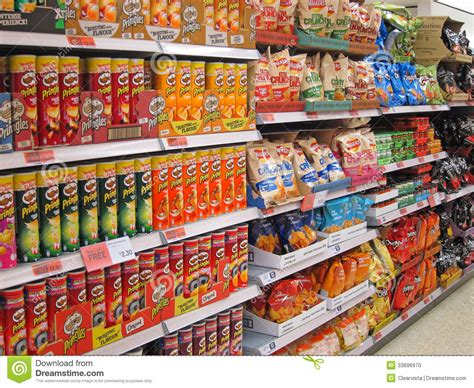 Shelf Of Potato Chips by Potato Chips Or Crisps On A Store Shelf Editorial Image