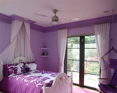 purple childrens bedrooms dark purple trim around ceiling and bed drape from ceiling