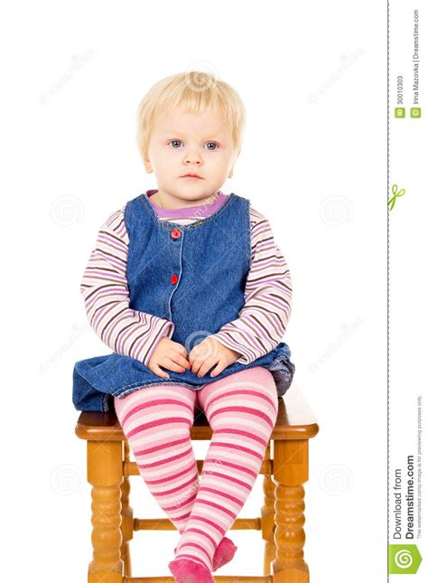 little girl on chair little girl sitting on a chair stock image image 30010303