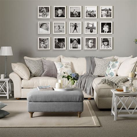 Taupe And Grey Living Room by Grey And Taupe Living Room With Photo Display Decorating