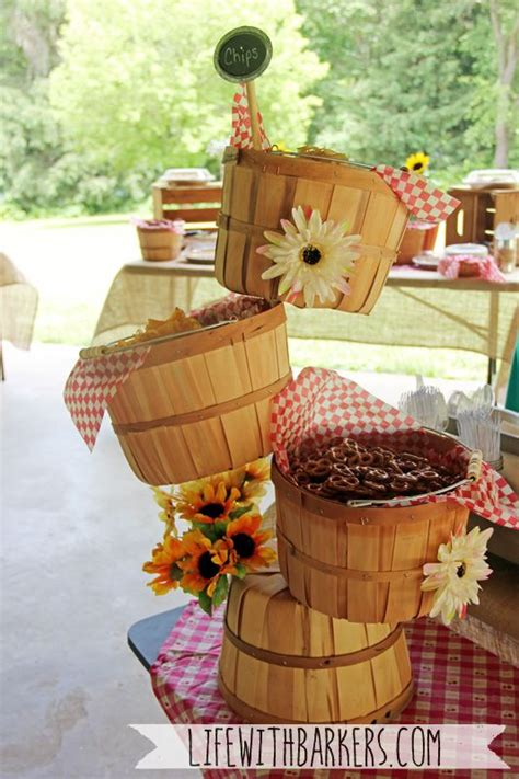 a co ed rustic country backyard park bbq barbeque themed baby shower orchard basket snack tower