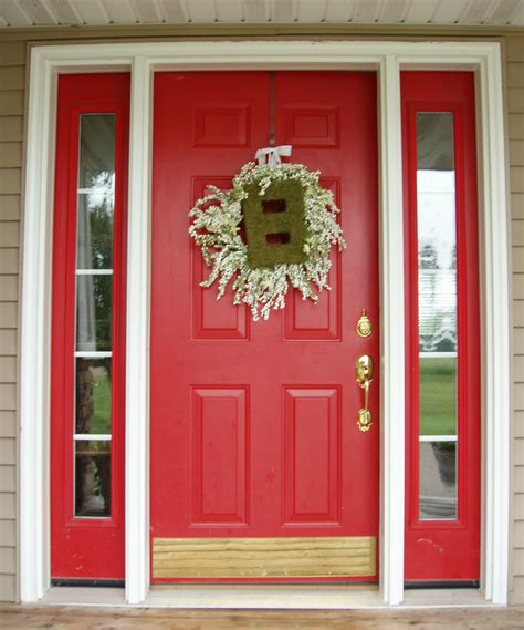 red door home decor bright red front door idea with unique wreath decor and