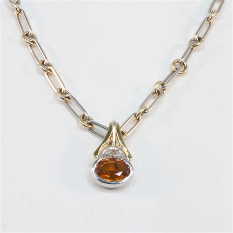 platinum and 18k yellow gold sapphire and pendant
