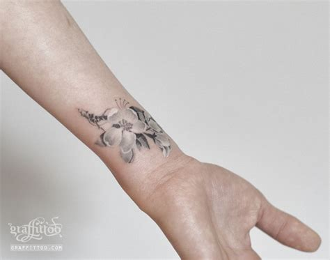 cherry blossom wrist tattoo cherry by tatuyiseuteu river cherry blossom