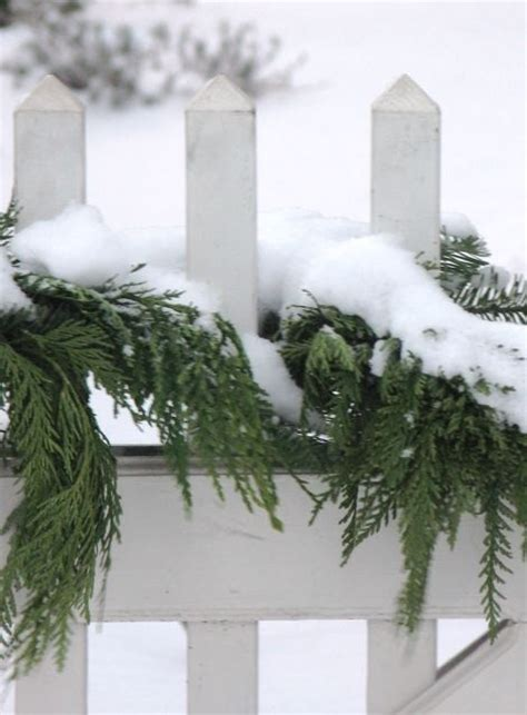 images of christmas garland on a fences 17 best images about fence ideas on picket fences snow and fence posts