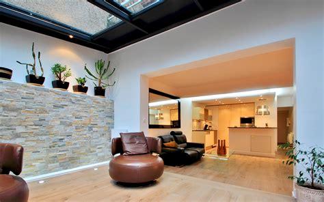 Rénovation véranda alu anthracite sur jardin zen 75019 Paris