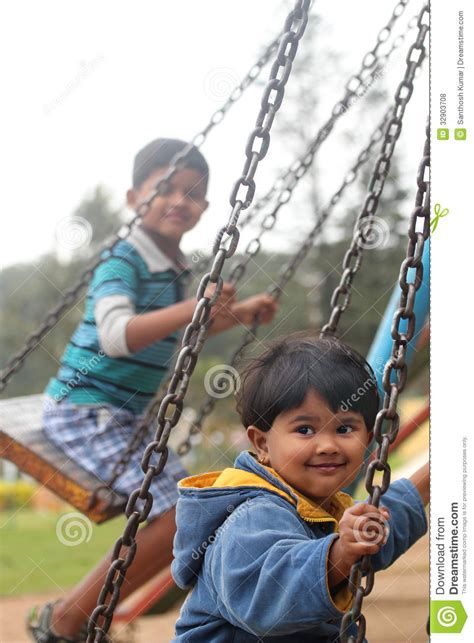 Set Shown Kid happy on swing sets in a park
