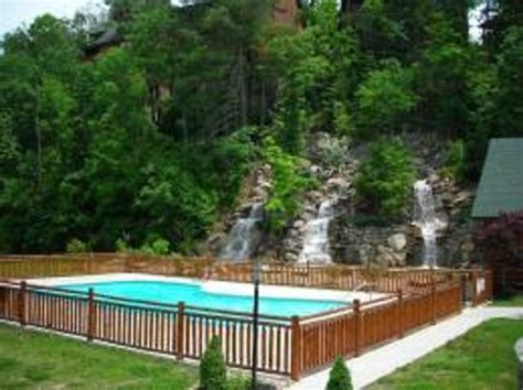 Creek Crossing Cabins by Gorgeous 65ft Waterfall Swimming Pool Area