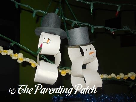 How To Make A Paper Snowman Chain - snow on snowman snowflakes and snow flake