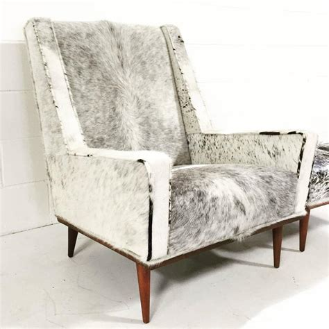 cowhide chair and ottoman milo baughman style chair and ottoman in brazilian cowhide