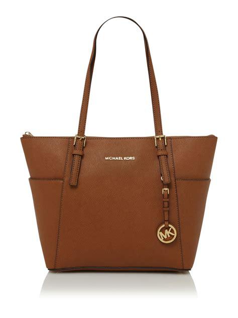 light brown mk purse michael kors jet set travel ziptop tote bag in brown lyst