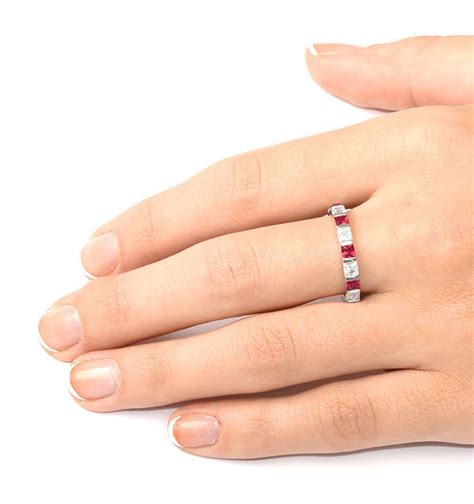 Ruby 18 25ct ruby 1 25ct and h si 18kw gold eternity ring