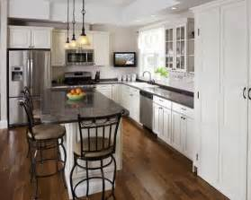 Traditional l shaped kitchen idea in boston with raised panel cabinets