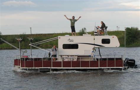 living on a boat vs rv floating dock converted into a cer barge