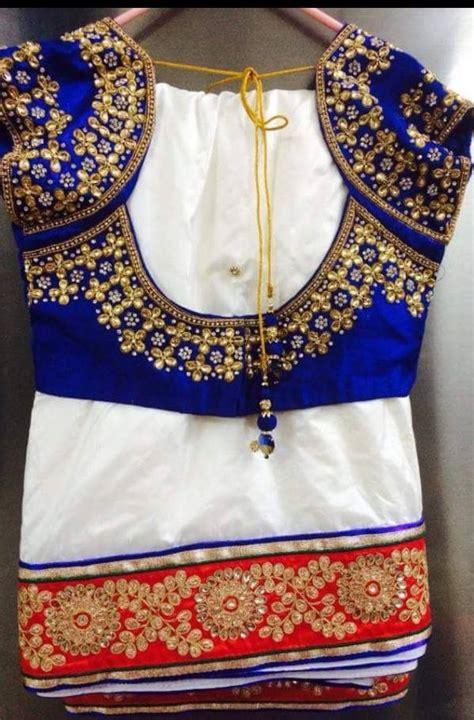 Blouse Designs For Heavy Sarees by White Saree With Heavy Border Teamed With Contest Blue