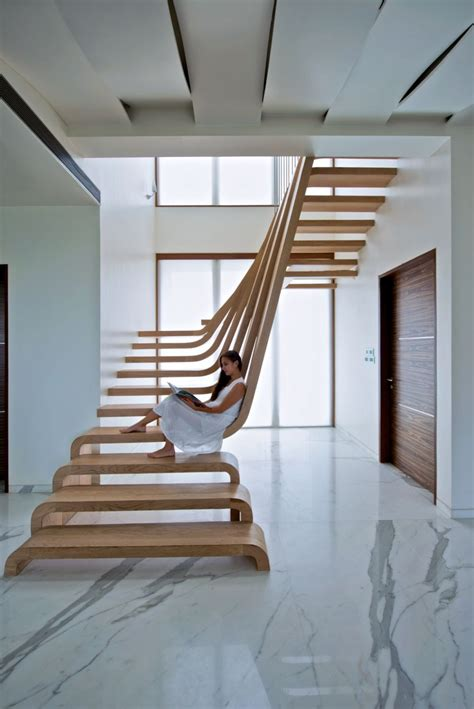 trendy home with super unique staircase sculptural staircase defines a modern two storey apartment