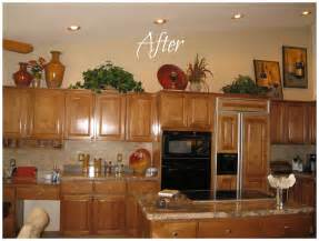 How To Decorate Above Kitchen Cabinets how do i decorate above my kitchen cabinets la z boy