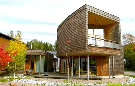 buy a house in finland spiraling green roofed espoo house clad in siberian larch up for sale in finland