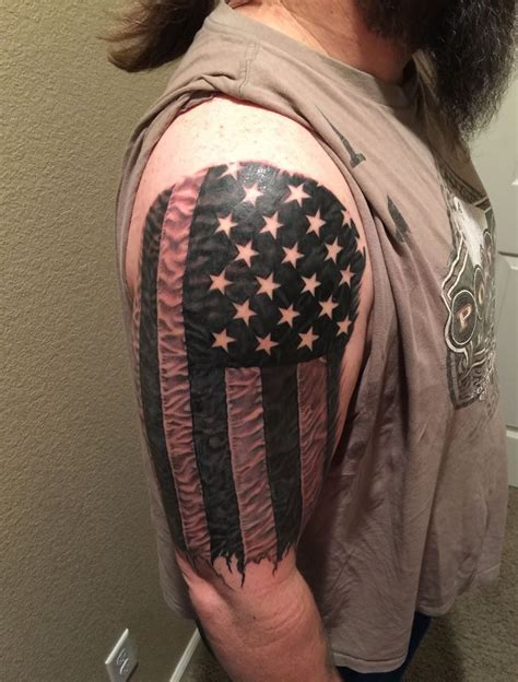 american sleeve tattoo american flag in photo realism black and white