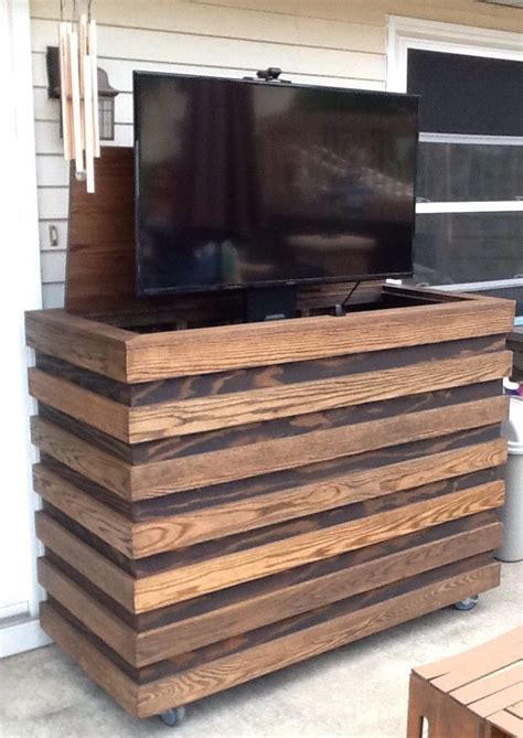 Outdoor TV. Homemade custom TV cabinet with remote TV lift