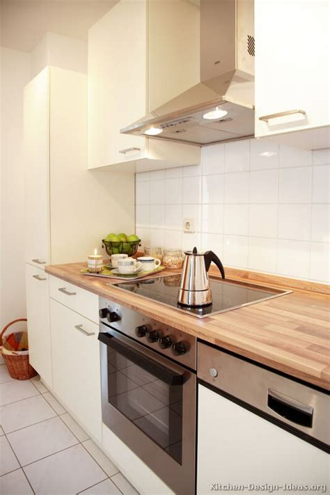 Wood Grain Laminate Kitchen Cabinets Small Kitchen Idea Of The Day White Cabinets And Tile With Light Wood Grain Laminate