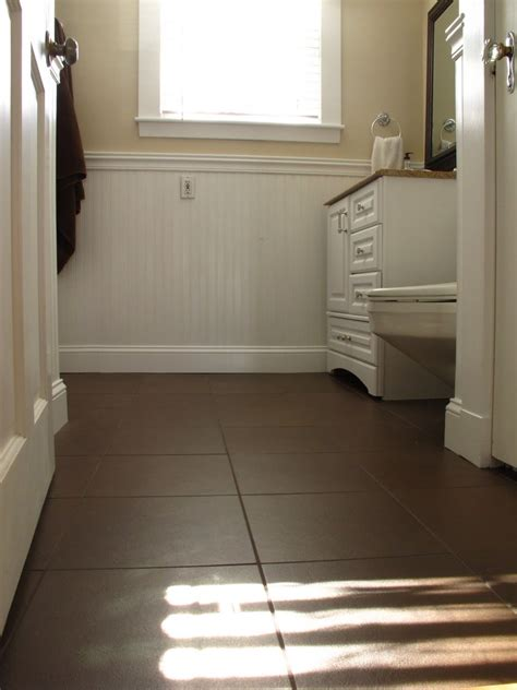 dark tile bathroom floor dark brown tile in bathroom floor white subway tile in