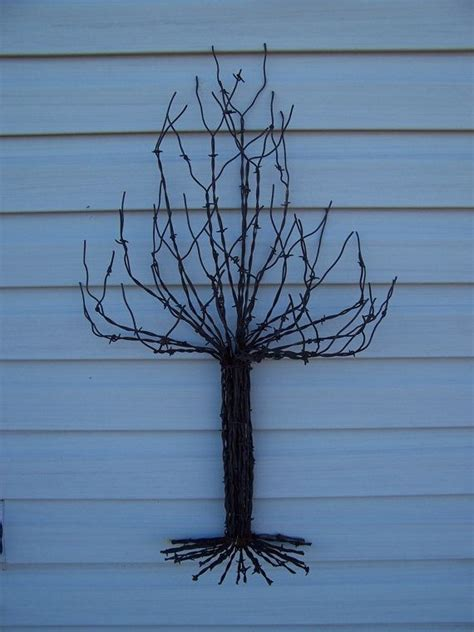 barbed wire tree pin by barbwireandbarnwood on barbed wire garden