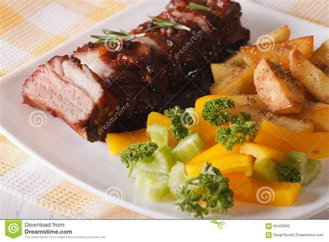 bbq pork ribs with a side dish of vegetables close up horizonta stock image image of lunch
