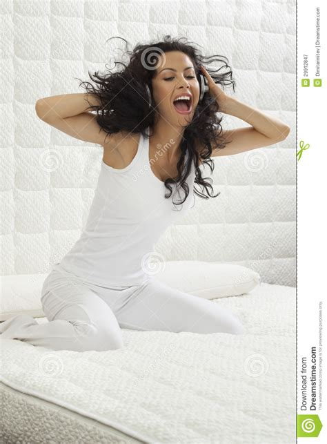 free music beds young woman listening music in bed royalty free stock photography image 29912847