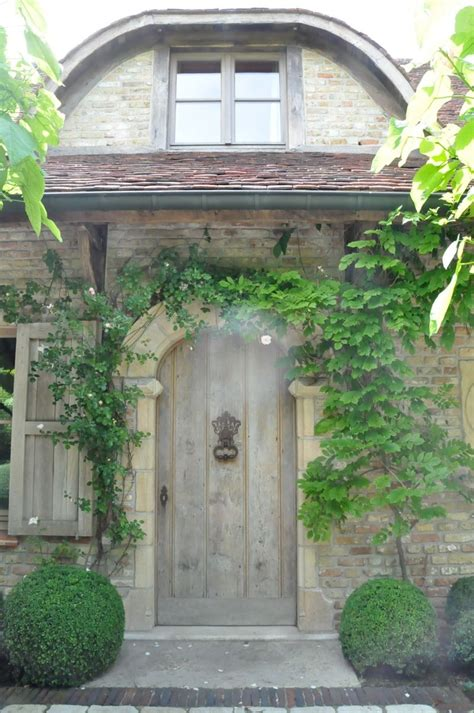 bungalow with charming facade hwbdo11716 charming character facade arched door rustic