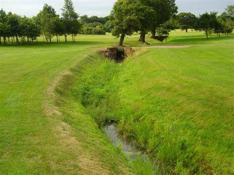golf club retaining walls with railway sleepers