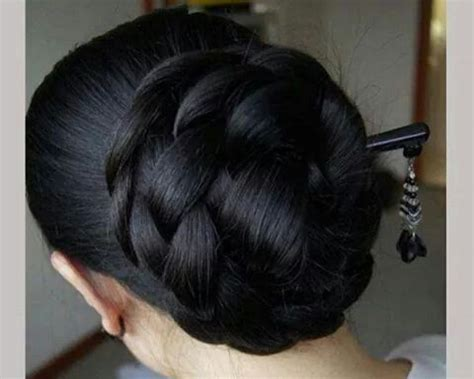 large bun with braid what a beautiful large low bun care however should be