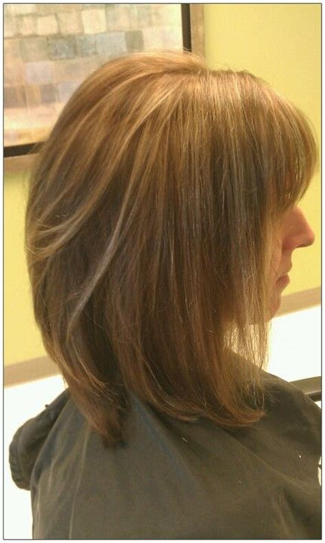 hair cut is lumpy layers not blending mocha caramel color with honey high lights and long bob cut with light blended layers cut