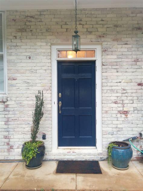 white    year  red brick   blue door
