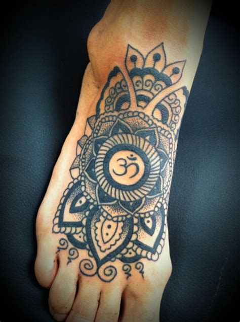 top of foot tattoo on tibetan om design and