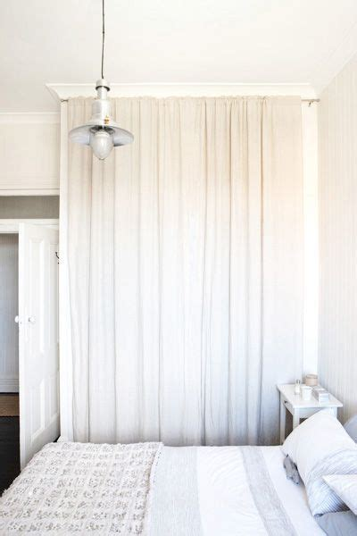 Replace Sliding Closet Doors With Curtains Take Out The Closet Doors And Use A Curtain Rod To Hang Two White Curtains Instead To Hide
